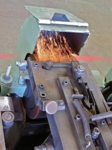 L'ébavurage pour ôter l'excès de métal