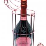 Cage rose dorée pour Laurent Perrier